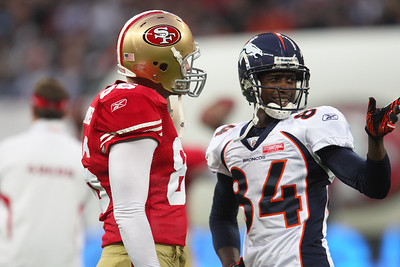 Denver Bronco's Brandon Lloyd speaks to SF Brain Jennings    during the NFL International Game at Wembley Stadium 31 Oct 2010