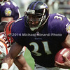 BALTIMORE, MD - SEPTEMBER 24: Running back Jamal Lewis #31 of the Baltimore Ravens carries the ball for several yards with the help of the blocking of his Lineman Edwin Mulitalo #64 while outrunning Defensive End Michael Bankston #90 and Defensive Tackle Tom Barndt #93 who are both of the Cincinnati Bengals in a NFL game at PSINet Stadium on September 24, 2000 in Baltimore, Maryland. The Ravens won the game 37-0. (Photo by Michael J. Minardi) *** Local Caption *** Jamal Lewis;Edwin Mulitalo;Michael Bankston;Tom Barndt