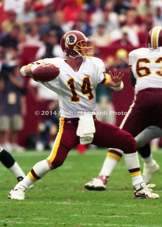 LANDOVER, MD - SEPTEMBER 3: Quarterback Brad Johnson #14 of the Washington Redskins sees a receiver and gets ready to pass during a NFL game against the Carolina Panthers at FedEx Field on September 3, 2000 in Landover, Maryland. The Redskins won 20-17. (Photo by Michael J. Minardi) *** Local Caption *** Brad Johnson