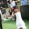 "A young visitor learns how to throw a football at the ""Quarterback Challenge"" interactive game at the 2012 Nike Festival of Sport"