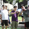 "Visitors learn how to throw a football at the ""Quarterback Challenge"" interactive game at the 2012 Nike Festival of Sport"