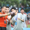 NFL player prospect, Ding Long (placekicker), shows visitors how to throw a football