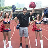 Mike Sui cheers with the New England Patriots Cheerleaders at the 2012 Nike Festival of Sport