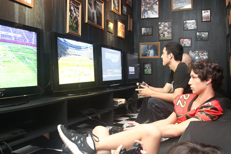 "Fans play ""Madden 13"" in the ""Nike Player Lounge"" at the 2012 Nike Festival of Sport"
