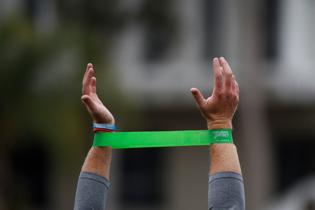 . Southern California quarterback Sam Darnold warms up with elastic bands during USC Pro Day, Wednesday, March 21, 2018, in Los Angeles. Pro day is intended to showcase talent to NFL scouts for the upcoming draft. (AP Photo/Jae C. Hong)