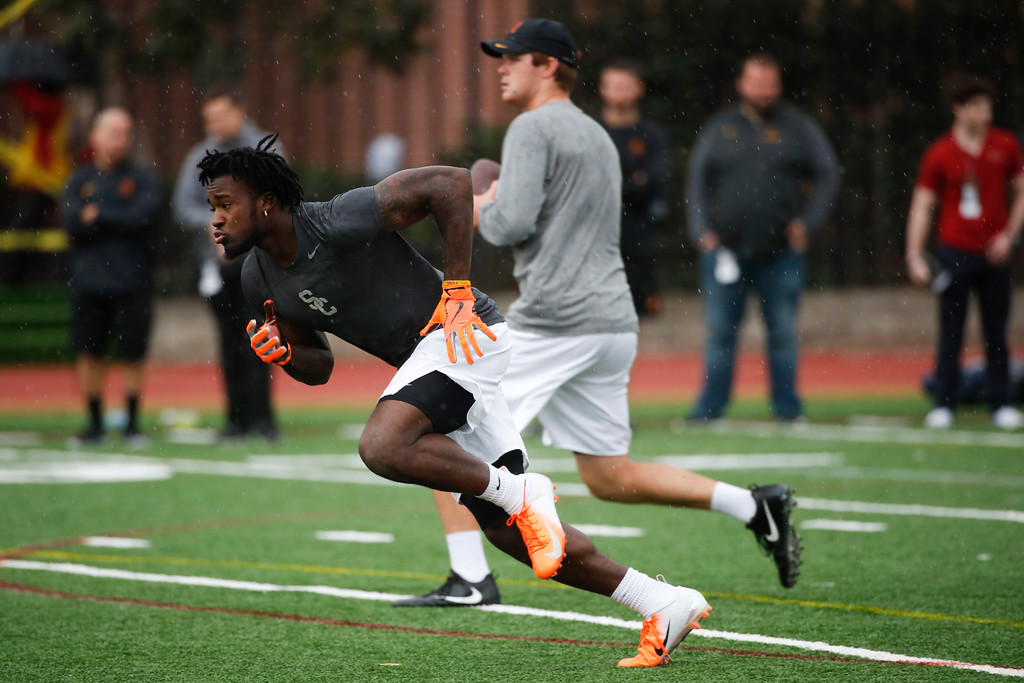. Southern California running back Ronald Jones and quarterback Sam Darnold participate in USC Pro Day, Wednesday, March 21, 2018, in Los Angeles. The Pro Day is intended to showcase talent to NFL scouts for the upcoming draft. (AP Photo/Jae C. Hong)