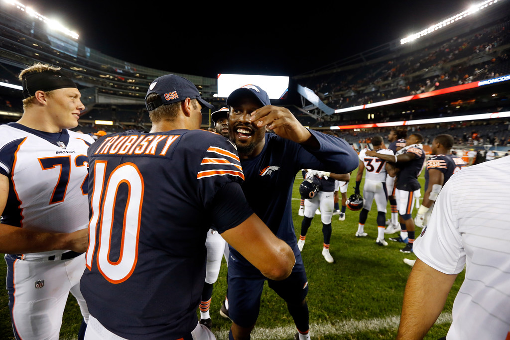. Chicago Bears quarterback Mitchell Trubisky (10) hugs Denver Broncos outside linebacker Von Miller (58) after an NFL preseason football game, Thursday, Aug. 10, 2017, in Chicago. The Broncos won 24-17. (AP Photo/Charles Rex Arbogast)