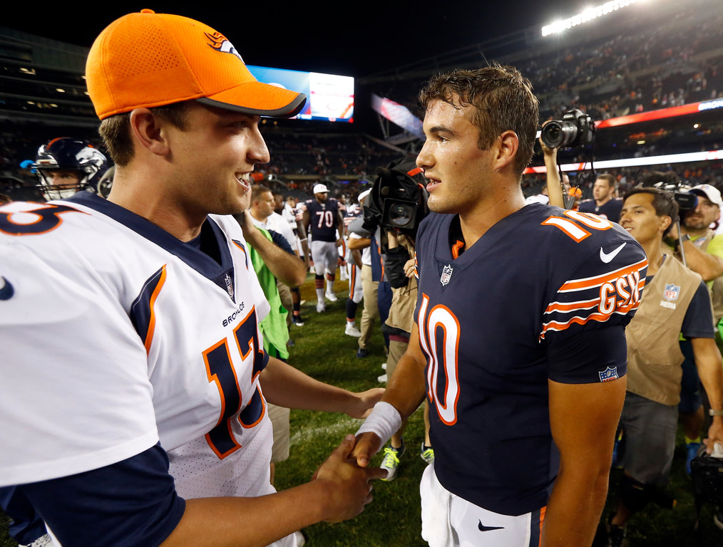 . Denver Broncos quarterback Trevor Siemian (13) shakes hands with Chicago Bears quarterback Mitchell Trubisky (10) after an NFL preseason football game, Thursday, Aug. 10, 2017, in Chicago. The Broncos won 24-17. (AP Photo/Charles Rex Arbogast)