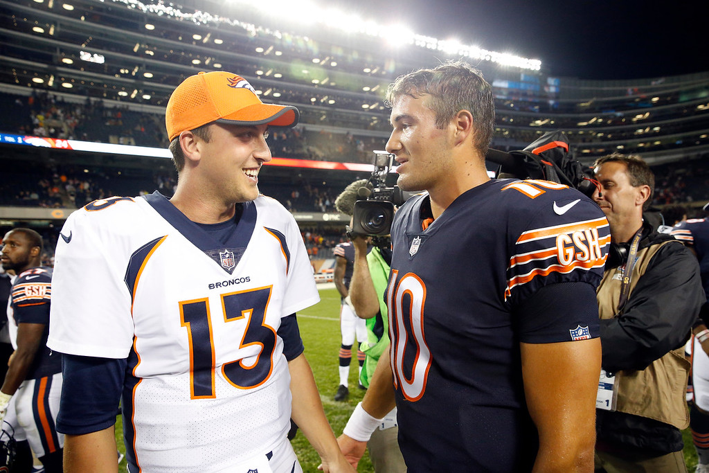 . Denver Broncos quarterback Trevor Siemian (13) talks to Chicago Bears quarterback Mitchell Trubisky (10) after an NFL preseason football game, Thursday, Aug. 10, 2017, in Chicago. The Broncos won 24-17. (AP Photo/Nam Y. Huh)
