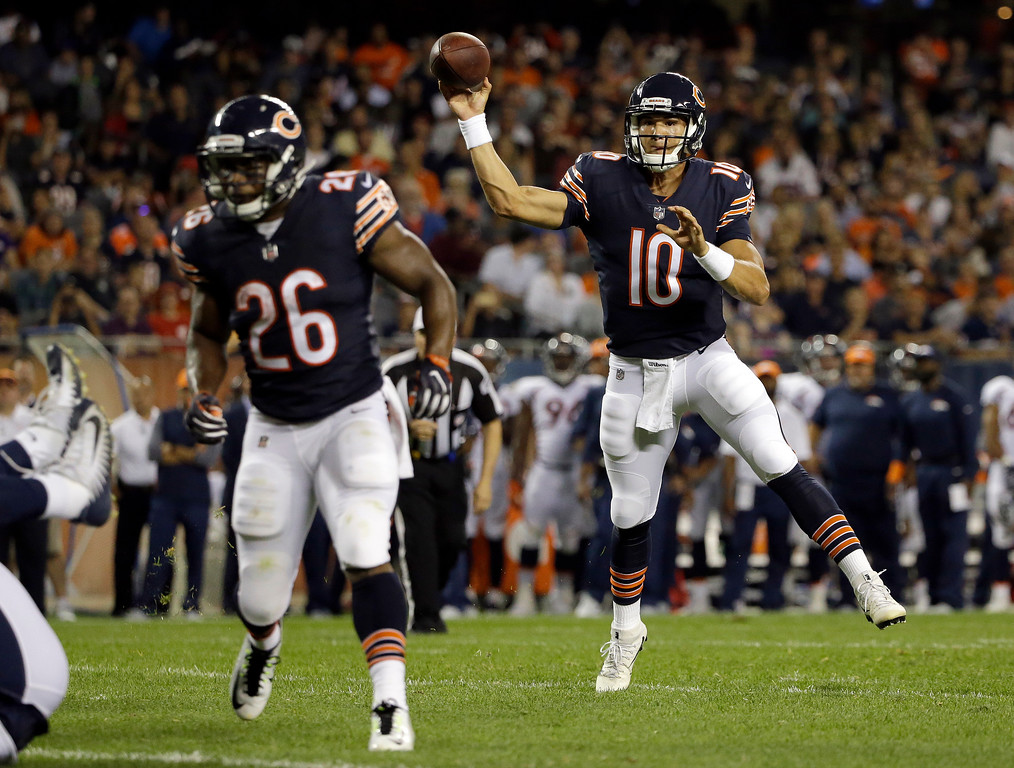 . Chicago Bears quarterback Mitchell Trubisky (10) throws a touchdown pass to wide receiver Victor Cruz (80) during the first half of an NFL preseason football game against the Denver Broncos, Thursday, Aug. 10, 2017, in Chicago. (AP Photo/Nam Y. Huh)