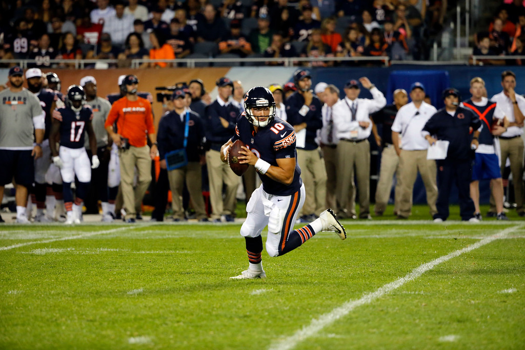 . Chicago Bears quarterback Mitchell Trubisky (10) scrambles during the second half of an NFL preseason football game against the Denver Broncos, Thursday, Aug. 10, 2017, in Chicago. (AP Photo/Charles Rex Arbogast)