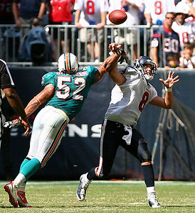 October 12, 2008 - With less than two minutes remaining in the fourth quarter, Miami Dolphins linebacker Channing Crowder gets a hand on Houston Texans quarterback Matt Schaub. Schaub capped off the drive with a three yard touchdown run in the final seconds to give the Texans a 29-28 win.
