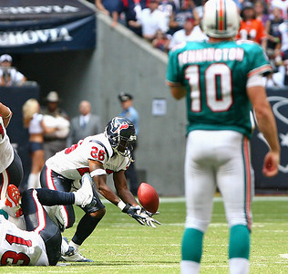 October 12, 2008 - Miami Dolphins quarterback Chad Pennington watches as Houston Texans safety Eugene Wilson intercepts a fourth quarter pass.  Wilson returned the interception 19 yards, but fumbled the ball on the run back, which the Dolphins recovered with 3:04 left in the game.