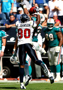 October 12, 2008 - Houston Texans receiver Andre Johnson reaches over Miami Dolphin safety Yeremiah Bell and comes away with a fourth down reception with 52 seconds left in the fourth quarter. The reception kept the Texans drive alive, which was capped by a three yard Matt Schaub touchdown run with three seconds left in the game to defeat the Dolphins 29-28.