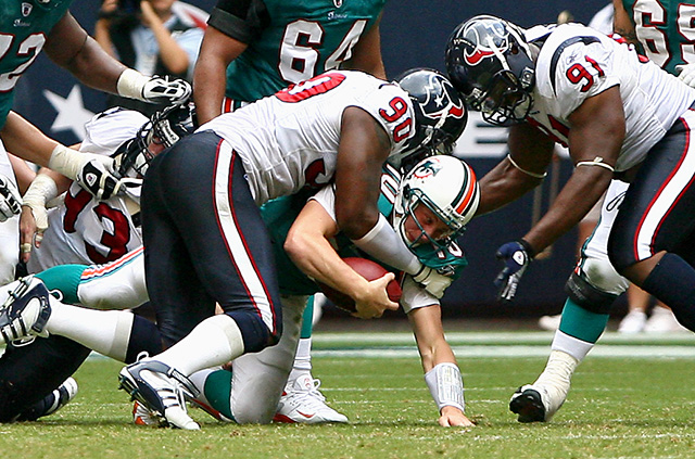 October 12, 2008 - Houston Texans linebacker Mario Williams brings down Miami Dolphins quarterback Chad Pennington.  Williams had two sacks on the day as the Texans defeated the Dolphins 29-28.