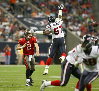 August 28, 2008 - Houston Texan linebacker Kevin Bentley attempts to block a pass from Tampa Bay Buccaneers quarterback Chris Simms.  The Texans finished their preseason with a 16-6 loss to the Buccaneers at Reliant Stadium in Houston.