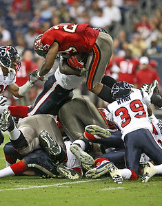 August 28, 2008 - Tampa Bay Buccaneers running back Michael Bennett attempts to leap ahead for a first down in the third quarter. The Houston Texans finished their preseason with a 16-6 loss to the Buccaneers at Reliant Stadium in Houston.