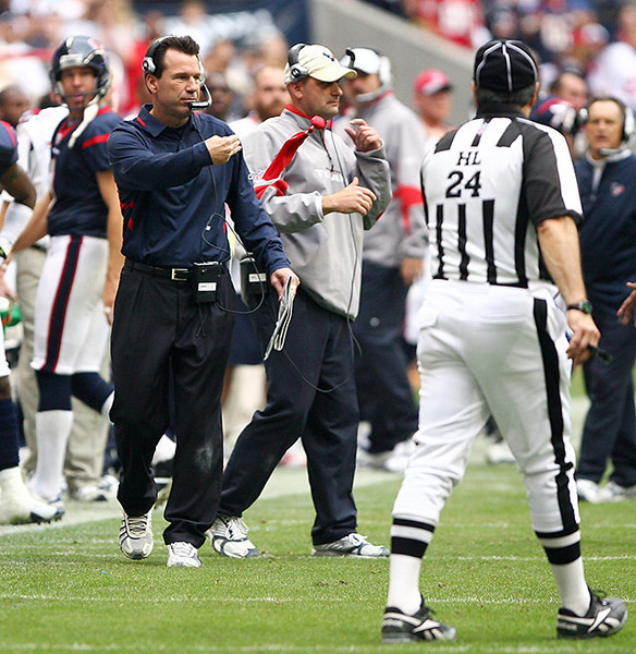 December 146, 2008 - Houston Texans head coach Gary Kubiak throws his red flag at the officials late in the game to challenge a call on the field.  The field call was upheld and the Texans were charged a timeout.  The Texans defeated the Tennessee Titans 13-12.