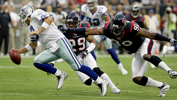 August 28, 2010 -Cornerback Glover Quinn sacks Cowboys quarterback Tony Romo in the first quarter. The Houston Texans defeated the Dallas Cowboys 23-7 in Preseason game number 3.