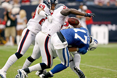 September 12, 2010- Houston Texans Glover Quinn and Bernard Pollard combine to force a fumble from Colts receiver Austin Collie deep in Texans territory during the third quarter.  Quinn recovered the fumble to keep the Colts from scoring. The Houston Texans open their 2010 season with a 34-24 win over the Indianapolis Colts.