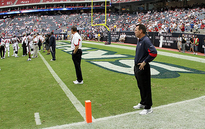 September 12, 2010- Houston Texans head coach Gary Kubiak watches his team make final preparations before the start of the 2010 season opener.  The Texans defeated the Indianapolis Colts 34-24.