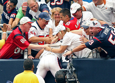 September 12, 2010- Houston Texans fans celebrate with wide receiver Kevin Walter after a 22 yard touchdown reception in the second quarter to give the Texans a 13-0 lead.  The Texans held on to win their 2010 season opener 34-24 over the Indianapolis Colts.