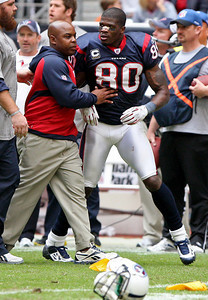 November 28 2010 - Houston Texans wide receiver Andre Johnson is restrained after a fourth quarter brawl with Tennessee Titans cornerback Cortland Finnegan.  Both Johnson and Finnegan were ejected for fighting.