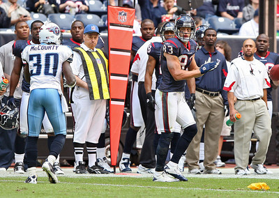November 28 2010 - Houston Texans wide receiver Kevin Walter applauds a penalty flag thrown for defensive pass interference against Tennessee Titans cornerback Jason McCourtry in the third quarter.
