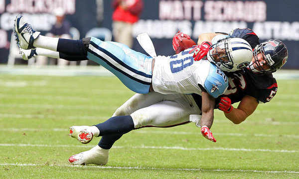 November 28 2010 - Brian Cushing tackles Tennessee Titans running back Chris Johnson for negative yardage in the second quarter.