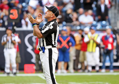 November 28 2010 - Umpire Garth DeFelice applauds during a third quarter salute to military heroes. The Houston Texans defeated the Tennessee Titans 20-0 at Reliant Stadium.