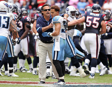 November 28 2010 - Tennessee Titans head coach Jeff Fisher tries to calm Cortland Finnegan after a fourth quarter brawl with Houston Texans wide receiver Andre Johnson.  Both Finnegan and Johnson were ejected from the game.