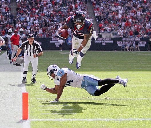 November 28 2010 - Houston Texans running back Arian Foster dives for the end zone during the first half.  Foster was short of the goal line, but the 16 yard pass play gave the Texans a first down at the one yard line.
