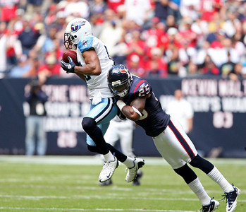November 28 2010 - Houston Texans cornerback Kareem Jackson makes a hit on Tennessee Titans wide receiver Justin Gage to force an incomplete pass. The Texans defeated the Titans 20-0 at Reliant Stadium.