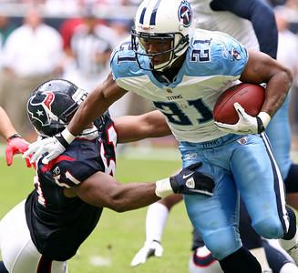 November 28 2010 - Tennessee Titans running back Javon Ringer rushes in the second quarter. Ringer averaged 6.8 yards per carry on 4 carries in the game.