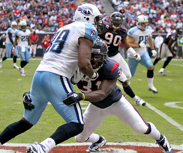 November 28 2010 - Houston Texans strong safety Bernard Pollard makes a tackle on Tennessee Titans tight end Jared Cook in the second half. The Texans defeated the Titans 20-0 at Reliant Stadium.