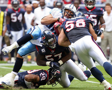 November 28 2010 - Houston Texans Brian Cushing and Kevin Bentley combine on a tackle to stop Tennessee Titans tight end Bo Scaife just short of a first down.