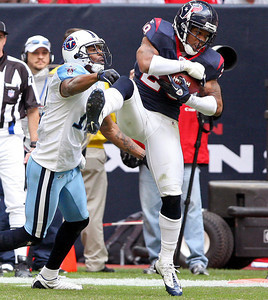 November 28 2010 - Houston Texans cornerback Glover Quinn pulls down an interception in the fourth quarter.  Quinn had three interceptions in the game as the Texans defeated the Tennessee Titans 20-0 at Reliant Stadium.