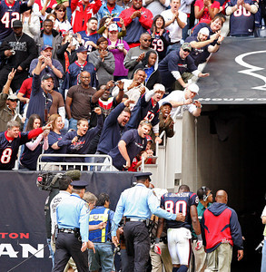 November 28 2010 - Fans cheer for Houston Texans wide receiver Andre Johnson as he is escorted from the playing field. Johnson was ejected along with Tennessee Titans cornerback Cortland Finnegan after a fourth quarter altercation.  The Texans defeated the Titans 20-0 at Reliant Stadium.