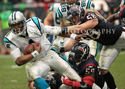 December 18, 2011; Houston, TX, USA; Carolina Panthers quarterback Cam Newton (1) rushes in the fourth quarter as Houston Texans outside linebacker Brooks Reed (58) and inside linebacker DeMeco Ryans (59) attempt to make the tackle at Reliant Stadium. The Panthers defeated the Texans 28-13. Mandatory Credit: Troy Taormina-US PRESSWIRE