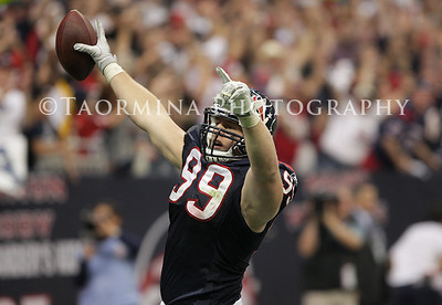 Jan 07, 2012; Houston, TX, USA; Houston Texans defensive end J.J. Watt (99) scores a touchdown after an interception against the Cincinnati Bengals during the second quarter of the 2011 AFC wild card playoff game at Reliant Stadium. Mandatory Credit: Troy Taormina-US PRESSWIRE