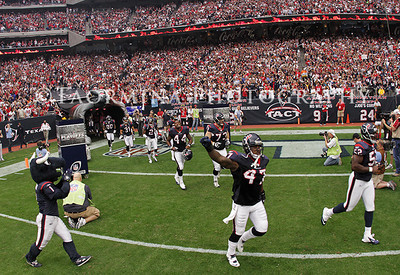 Jan 07, 2012; Houston, TX, USA; Members of the Houston Texans take the field before the 2011 AFC wild card playoff game against the Cincinnati Bengals at Reliant Stadium. Mandatory Credit: Troy Taormina-US PRESSWIRE
