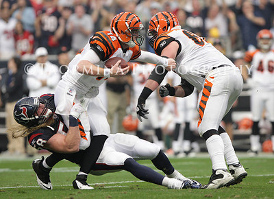 Jan 07, 2012; Houston, TX, USA; Houston Texans outside linebacker Brooks Reed (58) tackles Cincinnati Bengals quarterback Andy Dalton (14) during the second quarter of the 2011 AFC wild card playoff game at Reliant Stadium. Mandatory Credit: Troy Taormina-US PRESSWIRE