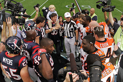 Jan 07, 2012; Houston, TX, USA; Members of the Houston Texans and the Cincinnati Bengals gather at midfield for the coin toss before the 2011 AFC wild card playoff game at Reliant Stadium. Mandatory Credit: Troy Taormina-US PRESSWIRE