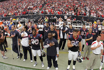 Jan 07, 2012; Houston, TX, USA; Members of the Houston Texans stand during the national anthem before the 2011 AFC wild card playoff game against the Cincinnati Bengals at Reliant Stadium. Mandatory Credit: Troy Taormina-US PRESSWIRE