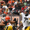 Michael Allen Blair/ MBlair@21st CenturyMedia.com<br /> Steelers' quarterback Ben Roethlisberger gets rid of a pass under pressure from Browns' defensive lineman Desmond Bryant during the second quarter of Sunday's game at FirstEnergy Stadium in Cleveland, OH. on November 24, 2013.