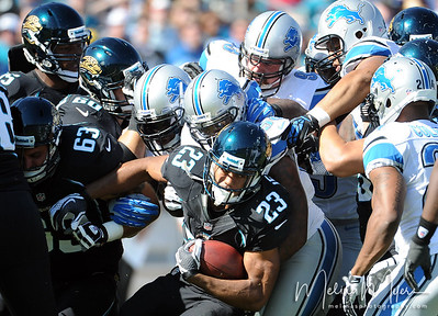 Nov 4, 2012; Jacksonville, FL, USA; Jacksonville Jaguars running back Rashad Jennings (23) is tackled during the first half of the game against the Detroit Lions at EverBank Field. Mandatory Credit: Melina Vastola-US PRESSWIRE.