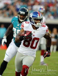 Aug 10, 2012;  Jacksonville, Florida, USA; New York Giants wide receiver Victor Cruz (80) runs the ball up the field during the first quarter of the preseason game against the Jacksonville Jaguars at EverBank Field. Mandatory Credit: Melina Vastola-US PRESSWIRE