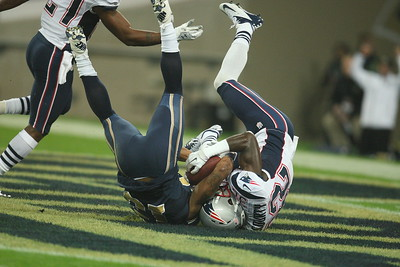 Devin McCourty tackles Chris Givens