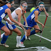 CARL RUSSO/Staff photo. Winnacunnet High defeated Salem High 2-0 in field hockey tournament action Thursday night. Salem's Mikaela Gauvain (left) and Amanda Travaglini (right) battle for the ball with Winnacunnet's Abigail Marchell. 10/25/2012.