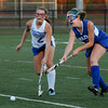 CARL RUSSO/Staff photo. Winnacunnet High School defeated Salem High School 2-0 in field hockey tournament action Thursday night. Salem's Rachael Denning (right) and Winnacunnet's Britni Ballance race for the ball. 10/25/2012.